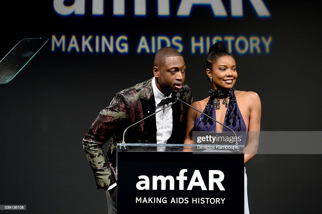Dwyane Wade(L) and Gabrielle Union speak onstage during the 7th Annual amfAR Inspiration Gala at Skylight at Moynihan Station on June 9, 2016 in New York City.