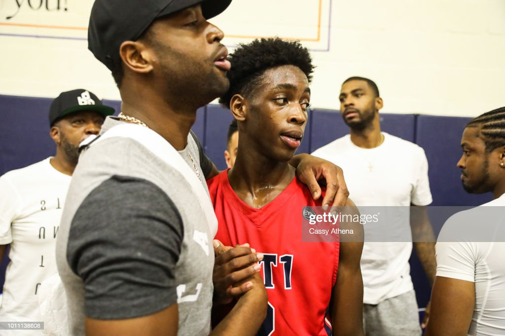 Dwyane Wade and his son Zaire Wade embrace after Zaire's AAU game at