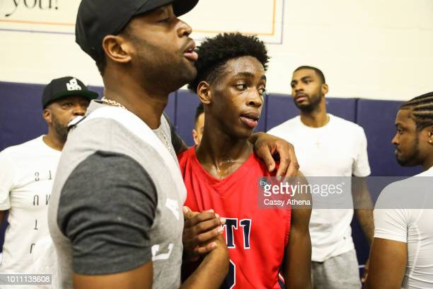 Dwyane Wade and his son Zaire Wade embrace after Zaire's AAU game at the Fab 48 tournament at Bishop Gorman High School on July 26 2018 in Las Vegas...