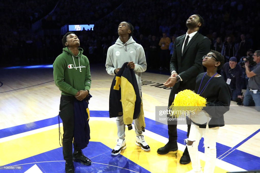 Dwyane Wade and his sons watch his retired number banner being