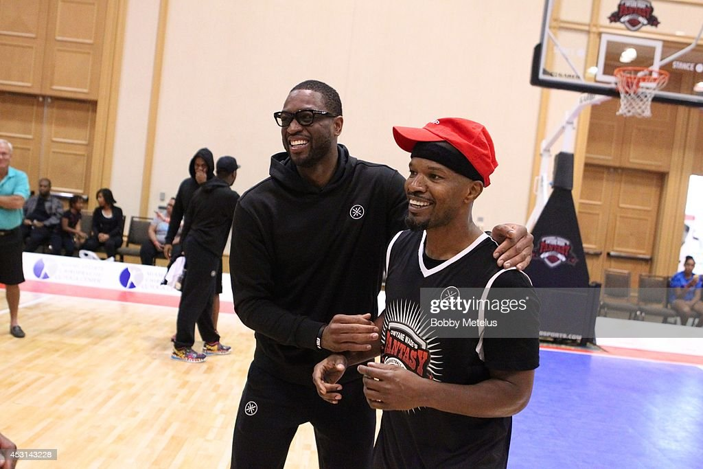 Dwyane Wade and Jamie Foxx after the championship game at Dwyane Wade's Fourth Annual Fantasy Basketball Camp at Westin Diplomat on August 3, 2014 in Hollywood, Florida.