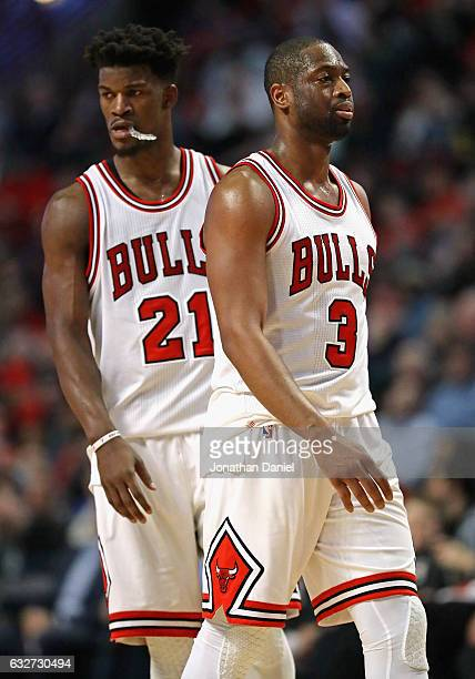 Dwyane Wade and Jimmy Butler of the Chicago Bulls react near the end of a game against the Atlanta Hawks at the United Center on January 25 2017 in...