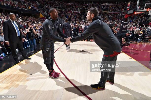 Dwyane Wade and Kevin Love of the Cleveland Cavaliers get introduced before the game against the Oklahoma City Thunder on January 20 2018 at Quicken...