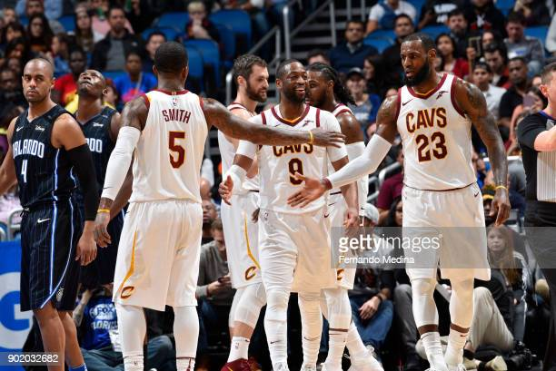 Dwyane Wade and LeBron James of the Cleveland Cavaliers with their teammates celebrates a win against the Orlando Magic on January 6 2018 at Amway...