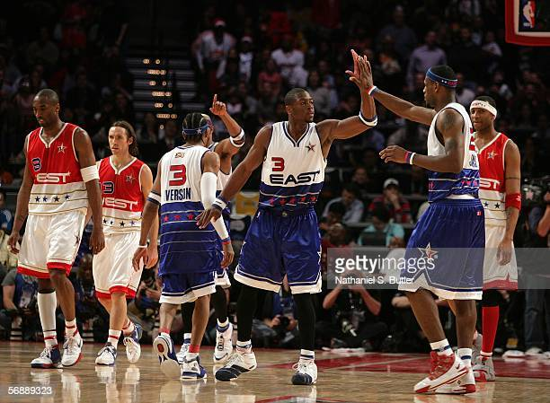 Dwyane Wade and LeBron James of the Eastern Conference celebrate against the Western Conference during the 2006 NBA AllStar Game February 19 2006 at...