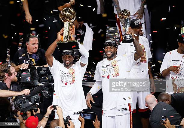 Dwyane Wade and LeBron James of the Miami Heat celebrate after defeating the San Antonio Spurs 9588 to win Game Seven of the 2013 NBA Finals at...