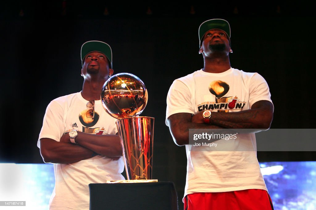 Dwyane Wade #3 and LeBron James #6 of the Miami Heat during a rally for the 2012 NBA Champions Miami Heat on June 25, 2012 at American Airlines Arena in Miami, Florida.