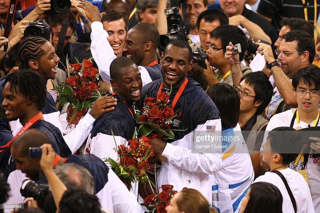 Dwyane Wade #9 (L) and LeBron James #6 of the U.S. Men's Senior National Team celebrate winning the men's gold-medal basketball game at the 2008 Beijing Olympic Games at the Beijing Olympic Basketball gymnasium August 24, 2008 in Beijing, China.