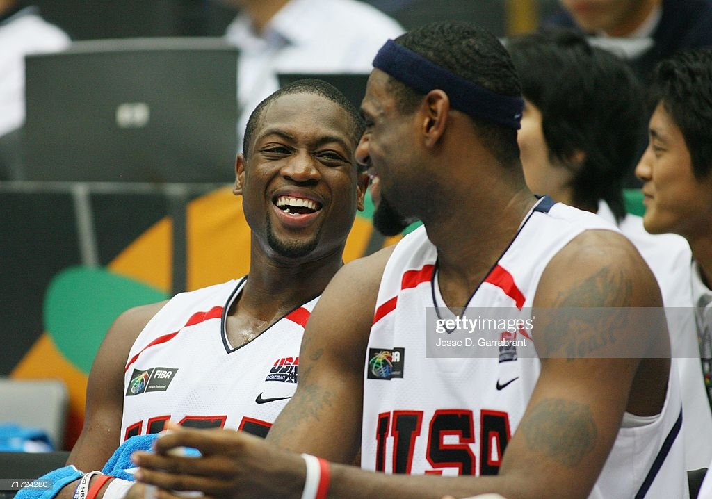 Dwyane Wade #9 and LeBron James #6 of the USA Basketball Mens National Team share a joke on the bench during the FIBA World Basketball Championship match against Australia at the Saitama Super Arena on August 27, 2006 in Saitama, Japan.