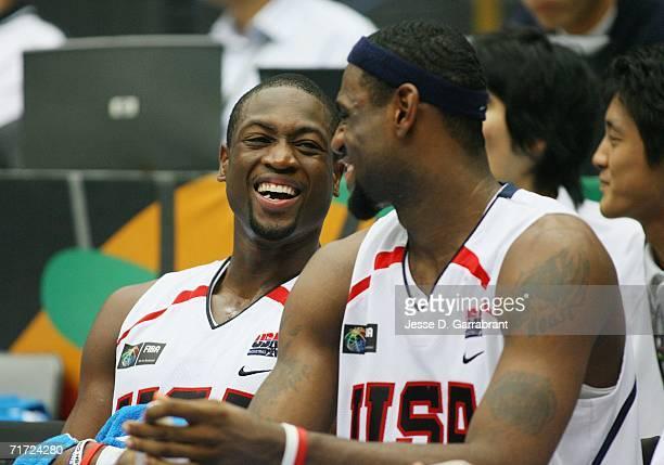 Dwyane Wade and LeBron James of the USA Basketball Mens National Team share a joke on the bench during the FIBA World Basketball Championship match...
