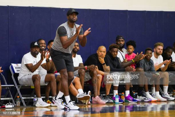 Dwyane Wade and LeBron James watch Zaire Wade's AAU game court side at the Fab 48 tournament at Bishop Gorman High School on July 26 2018 in Las...