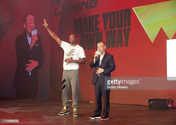 Dwyane Wade and Li Ning attend the WOW meet and greet on July 3 2013 in Beijing China