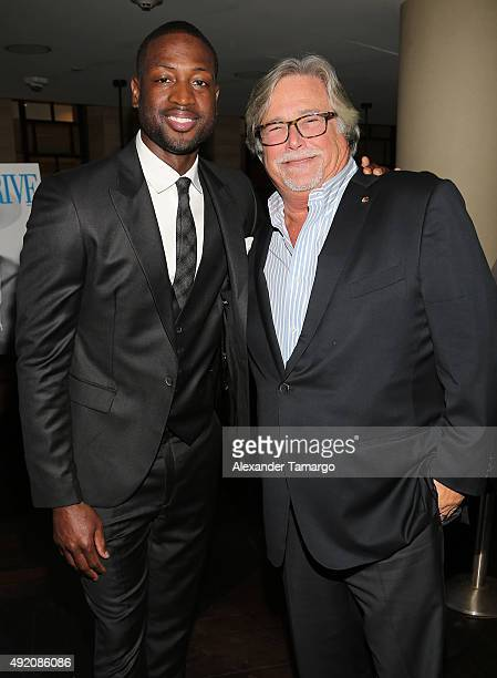 Dwyane Wade and Micky Arison are seen at Ocean Drive Magazine's October Men's Issue celebration at StripSteak by Michael Mina at the Fontainebleau on...