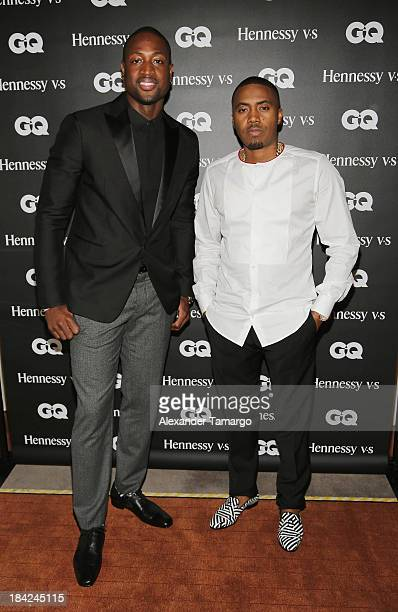 Dwyane Wade and rapper Nas attend the 'GQ Men' Book celebration presented by Hennessy on October 12 2013 in Miami Florida