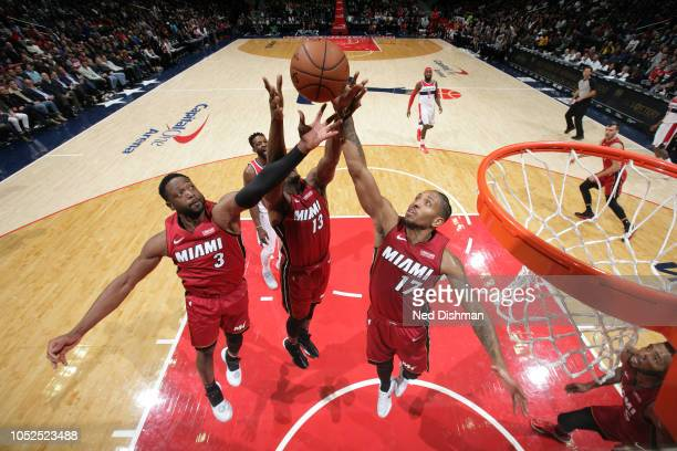 Dwyane Wade and Rodney McGruder of the Miami Heat grabs the rebound against the Washington Wizards on October 18 2018 at the Capital One Arena in...