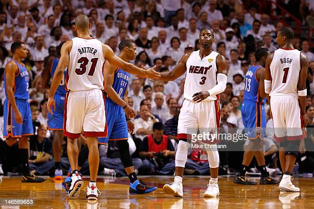 Dwyane Wade and Shane Battier of the Miami Heat react after an offensive play in the second half against the Oklahoma City Thunder in Game Four of...