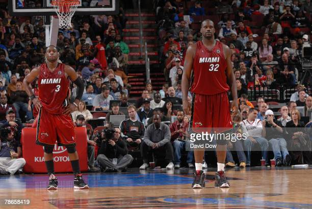 Dwyane Wade and Shaquille O'Neal of the Miami Heat stand on defense during the game against the Philadelphia 76ers on December 26 2007 at the...