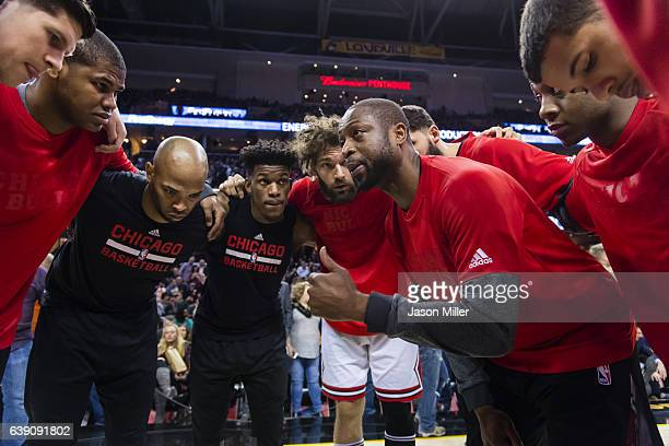 Dwyane Wade and the Chicago Bulls talk in the huddle prior to the game against the Cleveland Cavaliers at Quicken Loans Arena on January 4 2017 in...