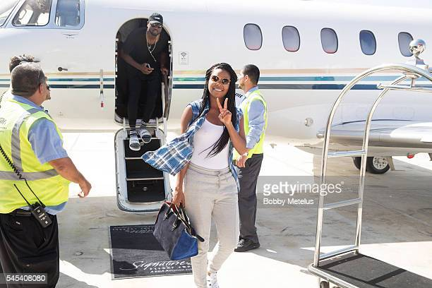 Dwyane Wade and wife Gabrielle Union arrive at OpaLocka Executive Airport on July 7 2016 in Miami Florida