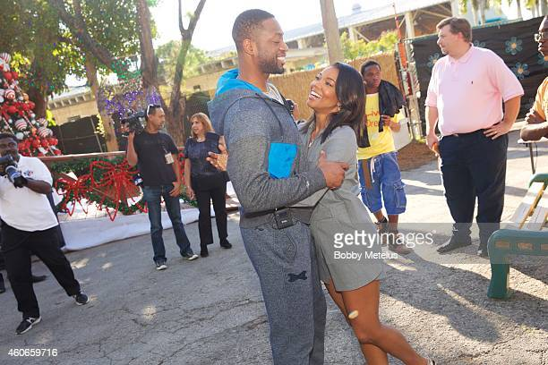 Dwyane Wade attends A fun filled day at Santa's Enchanted Forest for Wade's World Foundation '3 Under the Tree' Event at on December 18 2014 in Miami...
