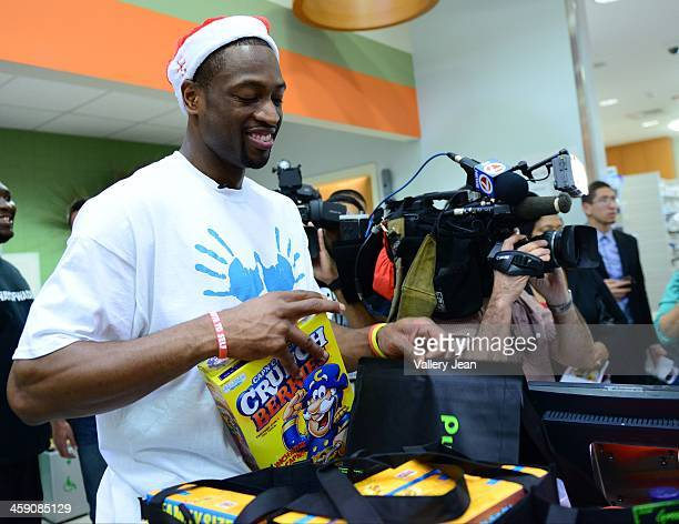 Dwyane Wade attends Publix Supermarket where Wade's World Foundation granted the wishes of deserving families on December 22 2013 in Plantation...