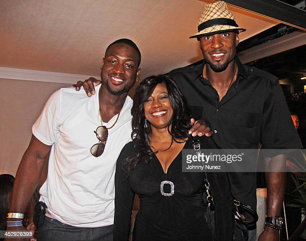 Dwyane Wade BernNadette Stanis and Alonzo Mourning attend the 2009 Essence Music Festival Presented by CocaCola at the Louisiana Superdome on July 4...