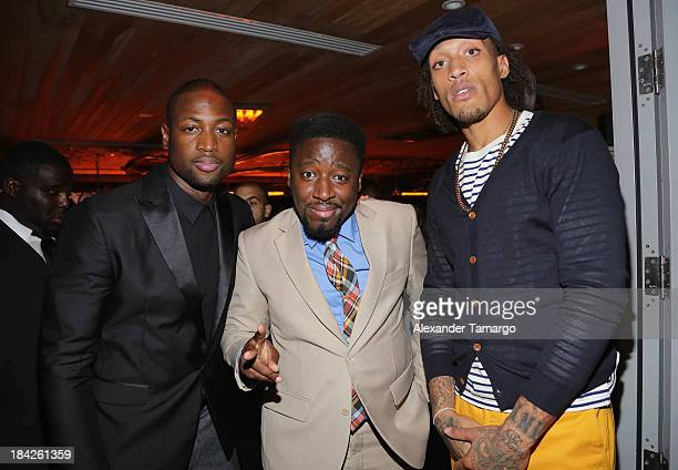 Dwyane Wade Bob Metelus and Michael Beasley attend the 'GQ Men' Book celebration presented by Hennessy on October 12 2013 in Miami Florida