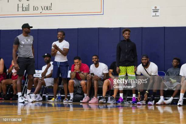 Dwyane Wade Dorell Wright LeBron James Jr LeBron James Sr and Bryce Maximus James watch Zaire Wade's AAU game court side at the Fab 48 tournament at...