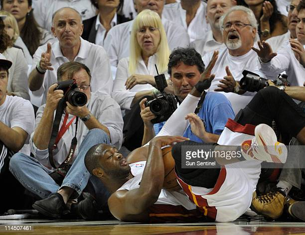Dwyane Wade falls off the court in the first quarter during Game 3 of the NBA Eastern Conference Finals at the American Airlines Arena in Miami...