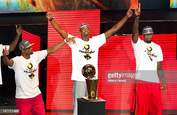 Dwyane Wade from left Chris Bosh and LeBron James of the Miami Heat celebrate their NBA world championship with their fans at the American Airlines...