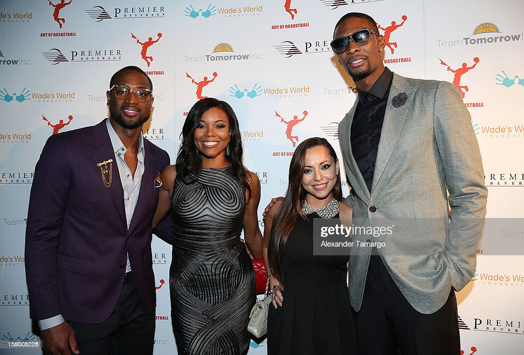 Dwyane Wade, Gabrielle Union, Adrienne Bosh and Chris Bosh make an appearance as Premier Beverage Hosts Art Of Basketball: Heat Wave With Dwyane Wade & Chris Bosh on December 7, 2012 in Miami, Florida.