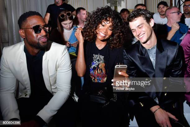 Dwyane Wade Gabrielle Union and Brandon Flynn attend the Balmain Menswear Spring/Summer 2018 show as part of Paris Fashion Week on June 24 2017 in...