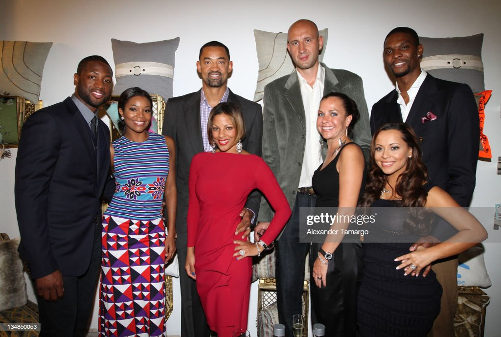 Dwyane Wade, Gabrielle Union, Juwan Howard, Janine Howard, Zydrunas Ilgauskas, Jennifer Ilgauskas, Chris Bosh and Adrienne Bosh attend 'Unlock' Art of Basketball Event during Graffiti Gone Global on December 3, 2011, 2011 in Miami, Florida.