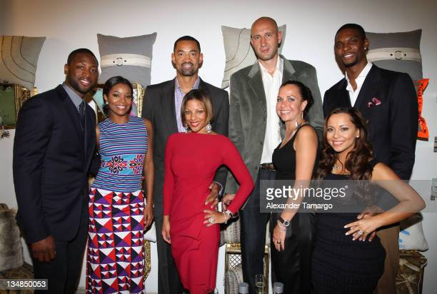 Dwyane Wade Gabrielle Union Juwan Howard Janine Howard Zydrunas Ilgauskas Jennifer Ilgauskas Chris Bosh and Adrienne Bosh attend Unlock Art of...