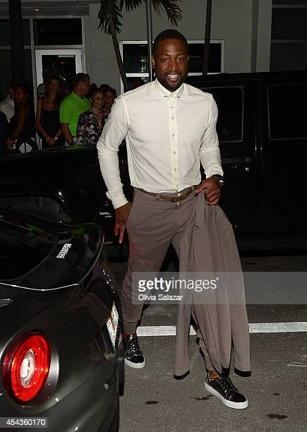 Dwyane Wade leaves his wedding rehearsal dinner at Prime 112 Steakhouse on August 29 2014 in Miami Beach Florida