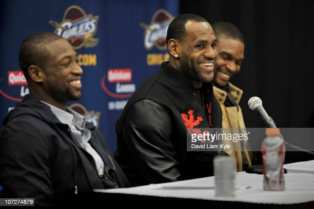 Dwyane Wade LeBron James and Chris Bosh of the Miami Heat answer questions from the media following a victory over the Cleveland Cavaliers at Quicken...