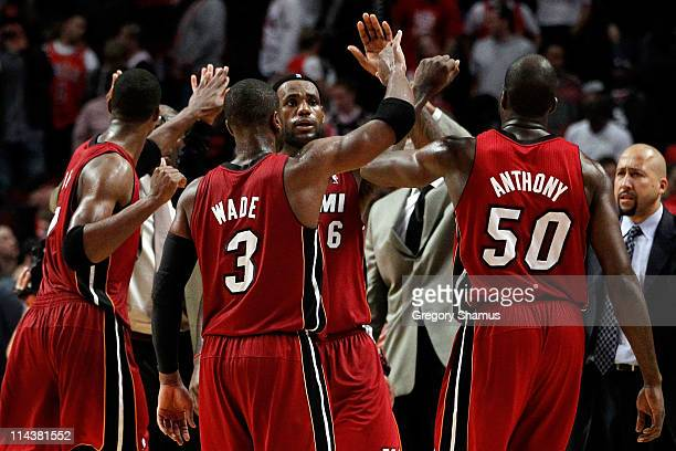 Dwyane Wade LeBron James and Joel Anthony of the Miami Heat celebrate after they won 8575 against the Chicago Bulls in Game Two of the Eastern...