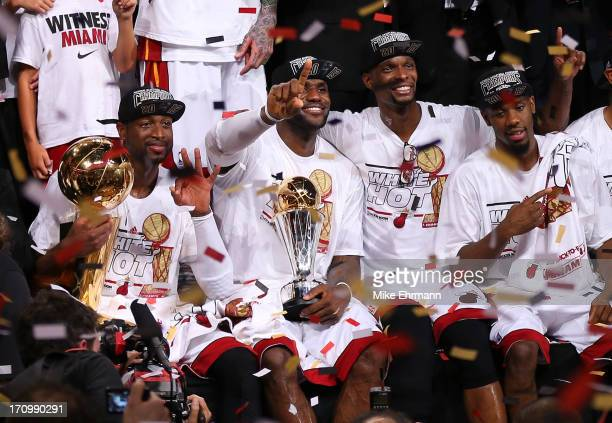 Dwyane Wade, LeBron James, Chris Bosh and Norris Cole of the Miami Heat celebrate after defeating the San Antonio Spurs 95-88 to win Game Seven of...