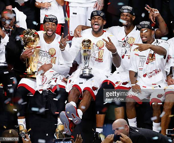 Dwyane Wade LeBron James Chris Bosh and Norris Cole of the Miami Heat celebrate after defeating the San Antonio Spurs 9588 to win Game Seven of the...