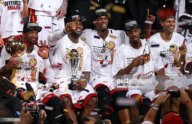 Dwyane Wade LeBron James Chris Bosh Norris Cole and Shane Battier of the Miami Heat celebrate after defeating the San Antonio Spurs 9588 to win Game...