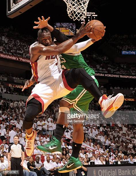 Dwyane Wade left of the Miami Heat is fouled by Glen Davis of the Boston Celtics in the first quarter of Game 5 of the NBA's Eastern Conference...