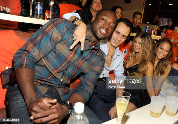 Dwyane Wade Marc Anthony Fergie and Jennifer Lopez attend the Miami Dolphins vs New York Jets hispanic heritage home season opener at Sun Life...