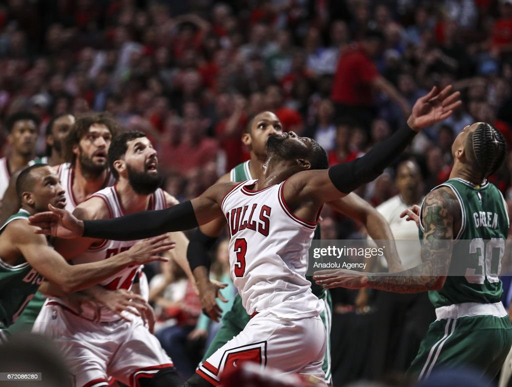 Dwyane Wade (3) of Bulls vies for the ball during the NBA match between Chicago Bulls and Boston Celtics at the United Center in Chicago, Illinois, United States on April 23, 2017.