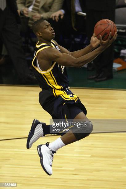 Dwyane Wade of Marquette University Golden Eagles drives to the basket during the semifinal round of the NCAA Final Four Tournament against the...