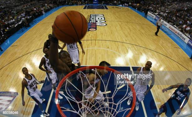 Dwyane Wade of Miami Heat dunks during the NBA preseason game as part of the 2008 NBA Europe Live Tour between New Jersey Nets and Miami Heat at the...