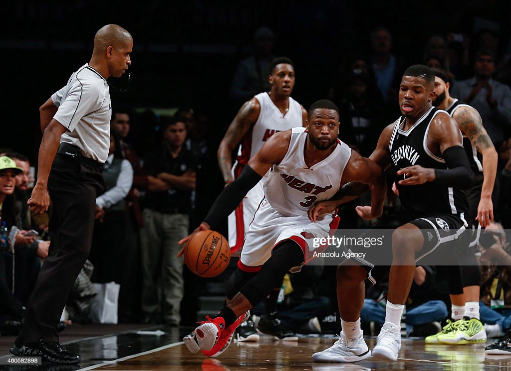 Dwyane Wade (L2) of Miami Heat in action against Joe Johnson (R) of the Brooklyn Nets during NBA basketball game between Brooklyn Nets and Miami Heat at the Barclays Center in the Brooklyn Borough of New York City, on December 16, 2014.