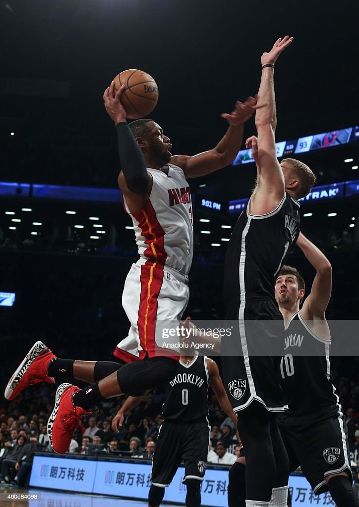 Dwyane Wade (R) of Miami Heat vies with Mason Plumlee (R) of Brooklyn Nets during a basketball game between Miami Heat and Brooklyn Nets at the Barclays Center on December 16, 2014 in the Brooklyn Borough of New York City.