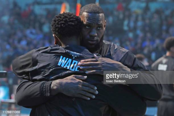 Dwyane Wade of Team LeBron and LeBron James of Team LeBron hug during the 2019 NBA AllStar Game on February 17 2019 at the Spectrum Center in...