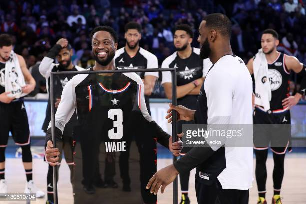 Dwyane Wade of Team LeBron receives commemorative AllStar jersey from LeBron James after the NBA AllStar game as part of the 2019 NBA AllStar Weekend...