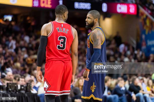 Dwyane Wade of the Chicago Bulls and Kyrie Irving of the Cleveland Cavaliers talk during the first half at Quicken Loans Arena on February 25 2017 in...